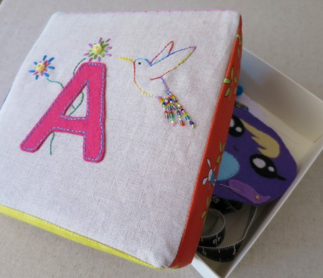 Box covers decorated with initials and patchwork sides